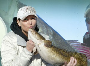 Kissing an eelpout.  (photo source)